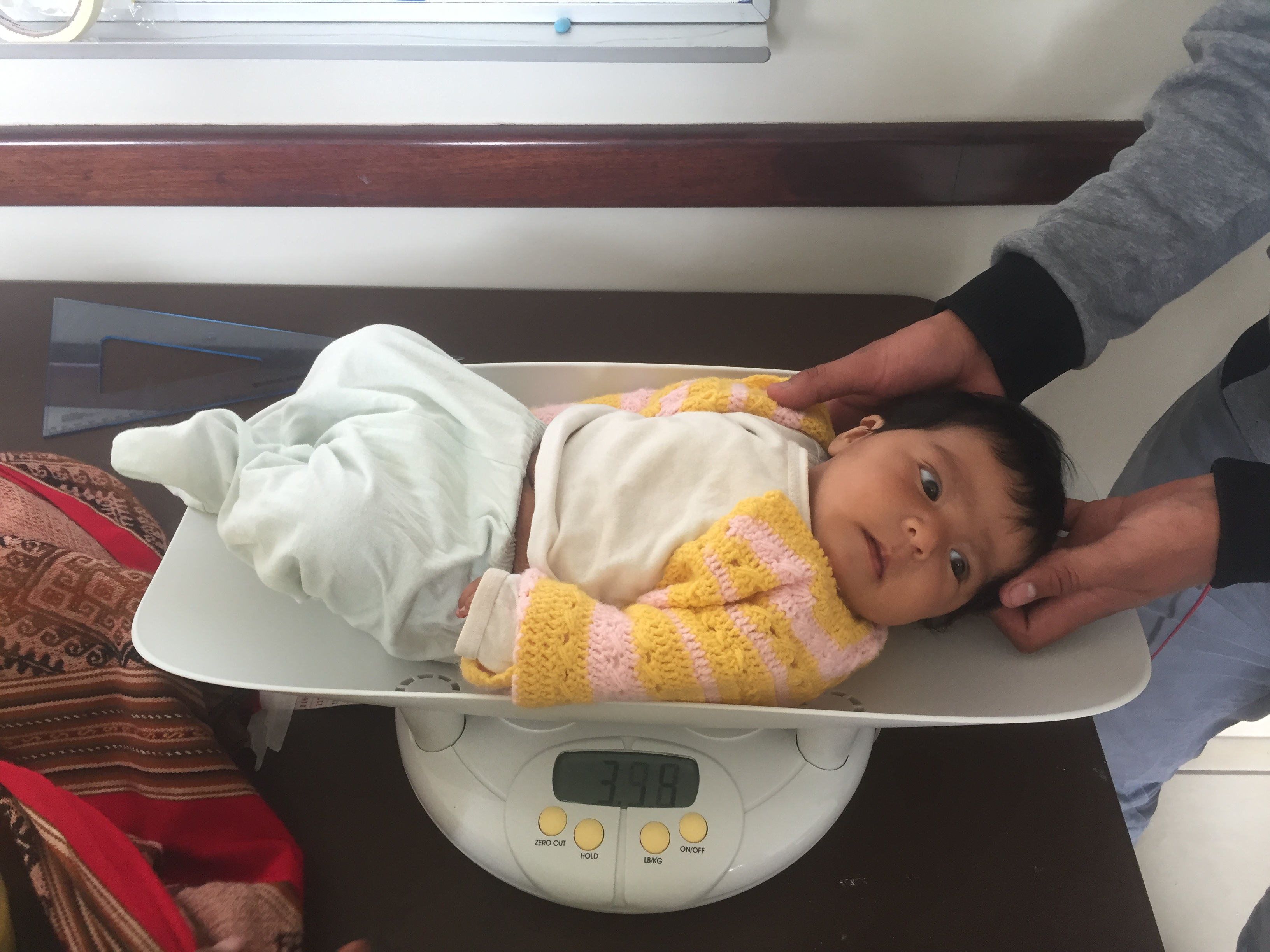 Urubamba-screening-baby-being-weighed-1